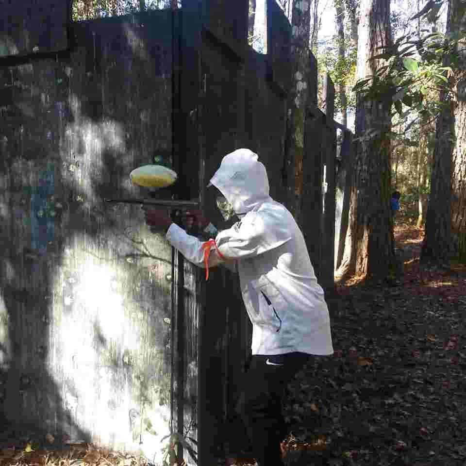 player on field at paintball adventures